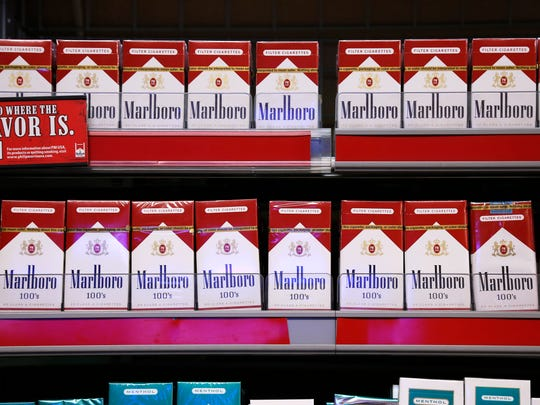 In this Friday, July 17, 2015 photo, Marlboro cigarettes, an Altria brand, are on display at a Smoker Friendly shop in Pittsburgh. (AP Photo/Gene J. Puskar)