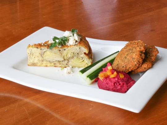 The Beet Hummus and Crustless Quiche are plated at Small Plates Thursday at Goudy Commons.