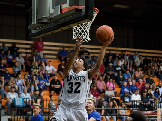 Oñate's Josh Harrison is left alone on a reverse lay up against Las Cruces on Saturday at OHS.