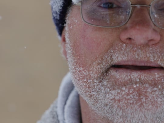 Wilson Junior High School groundskeeper Mike Schaff, who arrived at the school at 6 a.m. to start shoveling and blowing the snow, is covered in snow on Tuesday morning, March 1. Schaff said it could take him a whole day to do the work with the amount of snow Manitowoc received.