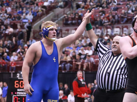 Garit Witt of Clyde wins against Ben Higgins of Alliance Marlington on Friday in the Division II 220 weight class.