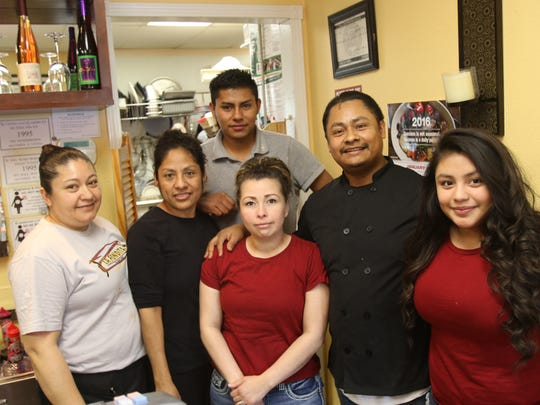 At La Fondita, it's definitely a family affair. Owner and chef Cuahutemoc Lopez (second from right) stands with his wife, Yvette Lopez, and daughter, Julissa Lopez (at right). In the back are Alejandra Flores, from left, sister Elvia Lopez and Benjamin Garcia.