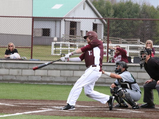 Brennan Laird of Earlham College connects with a pitch.