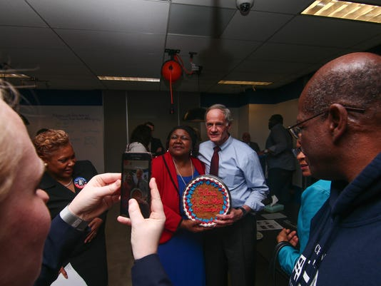 US Senator Tom Carper poses for photos with a Clinton supporters during A Clinton rally Thursday April 7, 2016, at 1313 Innovation in Wilmington.
