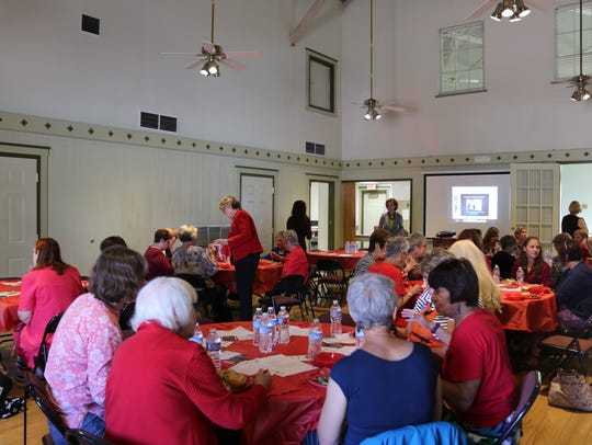 AAUW members discuss  equal pay during a luncheon April
