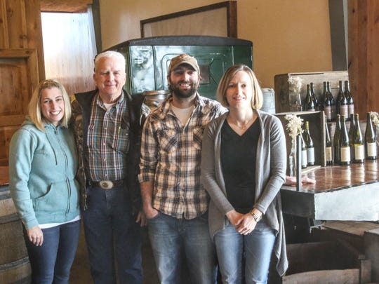 Robert Zielinski, second from left, and three of his children who help work the family farm, Twynann Naegeli, from left, Brian Zielinski and Tina Millican.