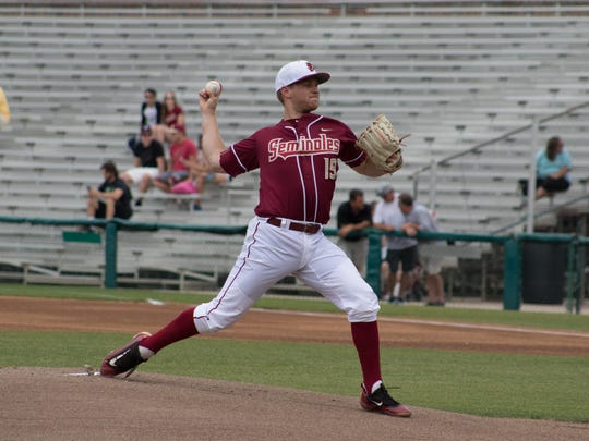 FSU pitcher Andrew Karp winds up for a pitch during