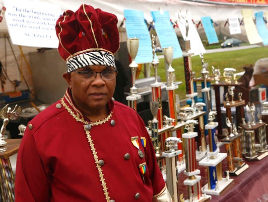 King of Ribs owner Ron Moton poses for a photo at his stand in 2016.