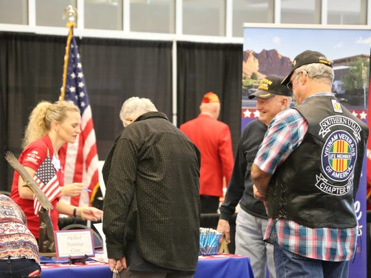 Friends and family gather at the Dixie Convention Center on April 23, 2016 to remember military members who have died.