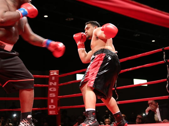 Pano Tiatia (right) fends off a punch from John Orr