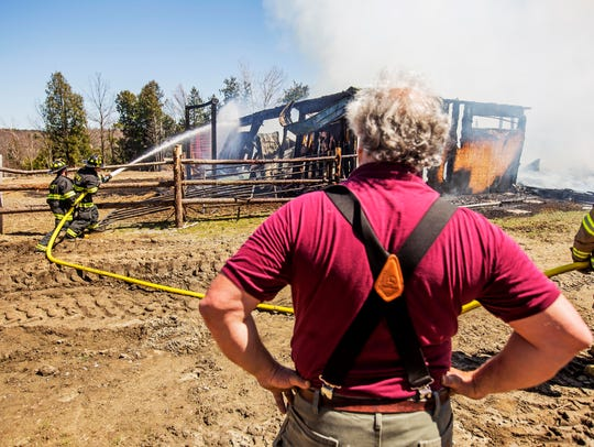 John Aubin watches as firefighters from six departments