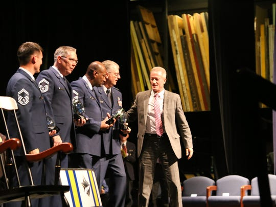 """Washington County School District Superintendent Larry Bergeson, right, pays tribute to the local JROTC program's instructors Friday during the high school leadership training program's awards ceremony. This year, all four Dixie High School JROTC instructors were granted """"Outstanding Instructor"""" status by the national JROTC headquarters."""