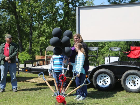 Ashley Blankenship prepares to release balloons in