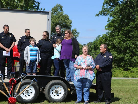 A groundbreaking ceremony was held Saturday on Old Pinson Road to dedicate a home in memory of Madison County Firefighter Chris Blankenship.