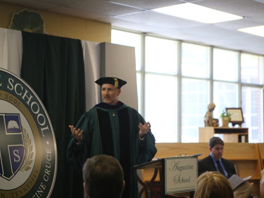 Brad Green, founder of Augustine School, speaks during graduation on Sunday, May 15, 2016.