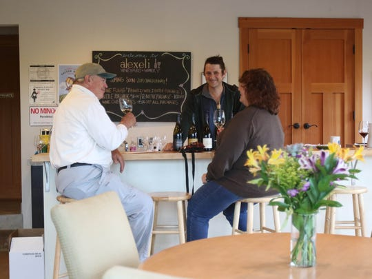 Winemaker and owner Phil Kramer discusses his wines with guests at Alexeli Vineyard and Winery in Molalla.