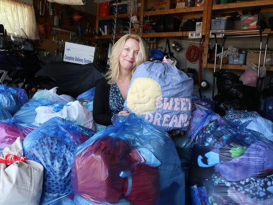 Gina Mattheisen holds the signature pillowcase package