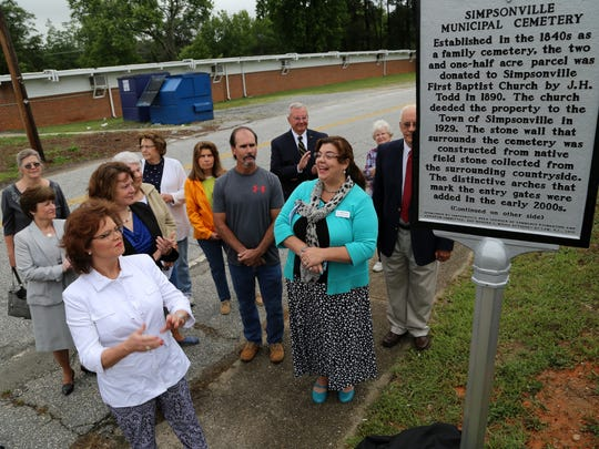 An unveiling and dedication ceremony was held Saturday, May 21 for the new historical marker awarded to the Simpsonville Municipal Cemetery. Mayor Janice Curtis and family members with ancestors buried in the cemetary assisted in the unveiling.