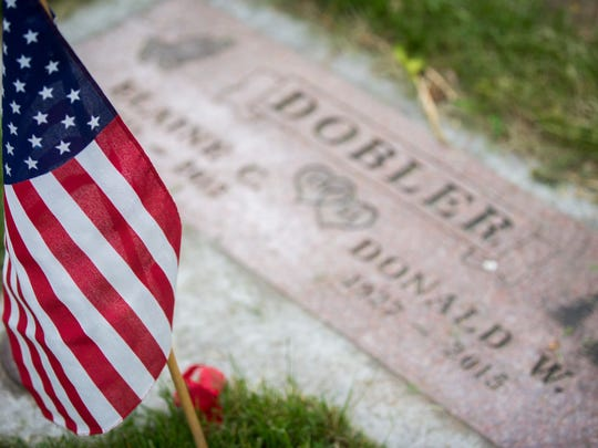 A flag stands in front of a United States veteran's grave at Grandview Cemetery in Fort Collins.