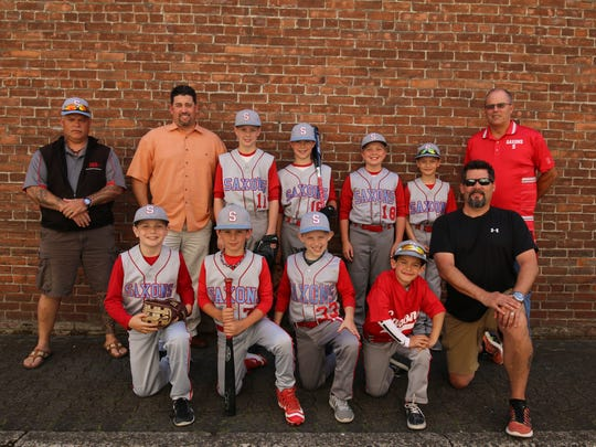 The Saxons contingent included (from left, back row) manager/coach Todd Raddle, manager/coach Shane Phelps, Spencer Elliott, Asa Phelps, Carter Elliott, Grant Gill and Dan Farrington. The front row included (from left) Caleb Mitchell, Jace Dalton, Colby Raddle, Brett Gill and coach Andrew Gill.