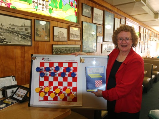 Denise Kean's magnetic checkerboard is helping dementia patients and others exercise their cognitive and physical skills.