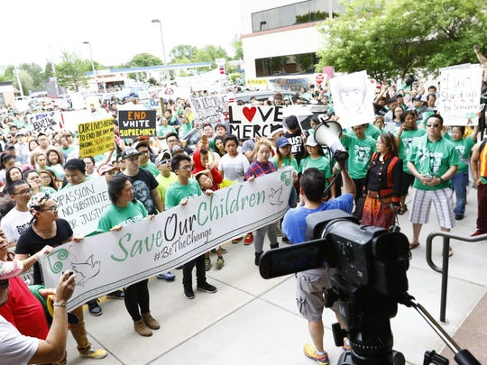Hundreds of demonstrators rally Tuesday afternoon at The 400 Block in downtown Wausau in a peace march inspired by the guilty verdict against 16-year-old Dylan Yang, who was convicted of homicide in March. Marchers walked past the Wausau Police Department, the Wausau School District's administration building and the Marathon County Courthouse.