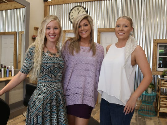 The team of sylists ar Rustic Roots includes, from left, owner Carlyn Reid, Shelby Phillips and Irina Reutov.