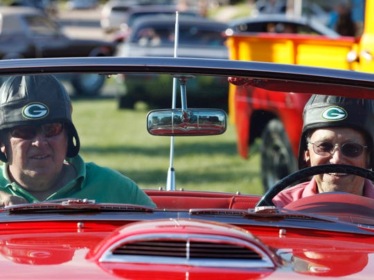 Mike Shallue, left, and Howard Zimmerman wear matching leather hats to go with the red 1957 Thunderbird at the 16th Annual Cool City Classic Car Show and Cruise in 2016.