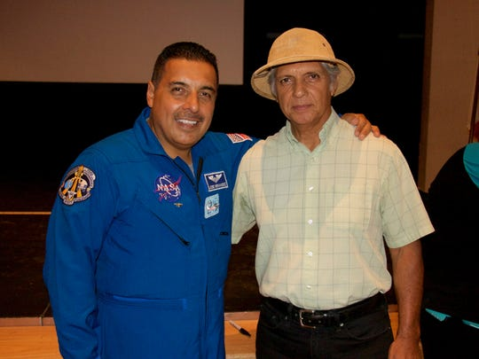 Manuel Jarvis-Martinez, a Coachella Valley Unified School District Board member (right), attends a lecture by retired astronaut Jose Hernandez (left)  at Desert Mirage High School in Thermal.