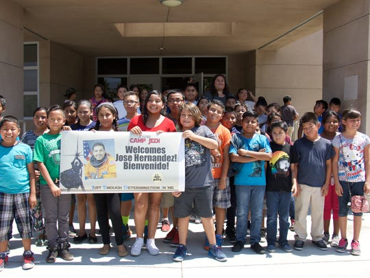 Students created a sign to welcome retired astronaut Jose Hernandez on June 22 to Desert Mirage High School.