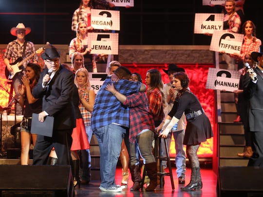 Katie and Kevin Sievert embrace after before Katie Sievert left the stage due to being eliminated in week one.