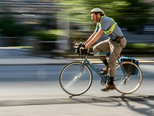 Attorney Marty Lessner rides his bike on King Street in Wilmington on Thursday. Wilmington plans to install a bike-sharing system.