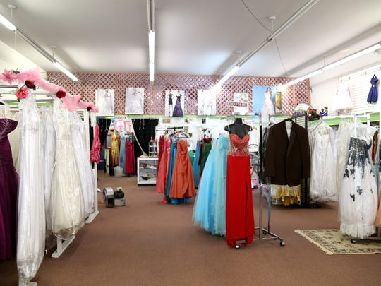Displays of men's and women's formal wear at Mildred's
