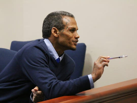 During a break in testimony, Jason McCrary chats with