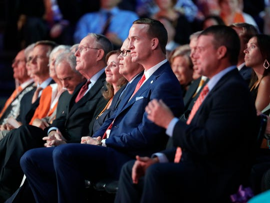 Former NFL and University of Tennessee quarterback Peyton Manning, center, listens to a speaker during a ceremony to celebrate the life of former Tennessee women's basketball coach Pat Summitt on Thursday, July 14, 2016, in Knoxville, Tenn.