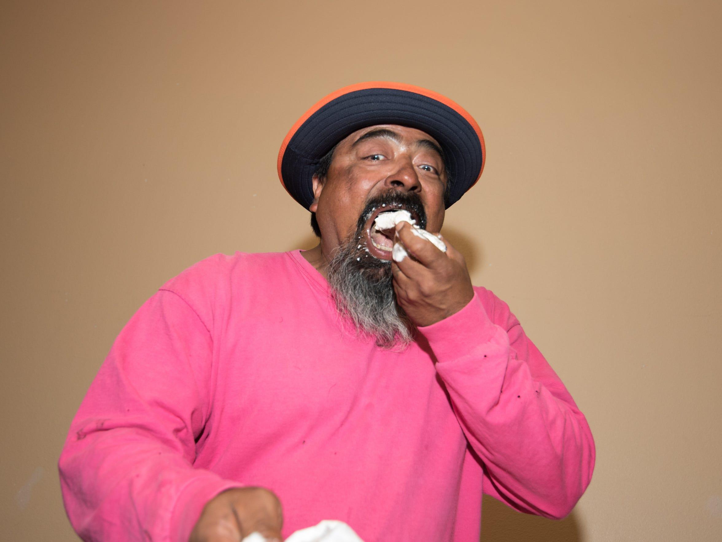 Ralph Araiza eats one of 13 ice cream bars for the