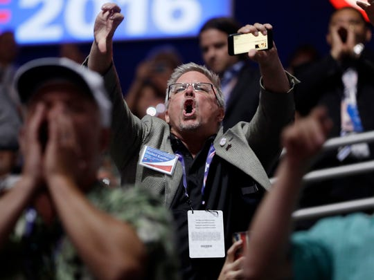 People react to Sen. Ted Cruz, R-Texas., as Cruz addresses the delegates during the third day of the Republican National Convention in Cleveland, Wednesday, July 20, 2016.