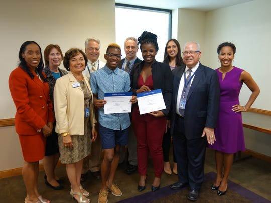 City of Poughkeepsie School District Superintendent Dr. Nicole Wiliams (far left) and members of the MidHudson Regional Hospital leadership team surround Sharief Dean-Holmes and Lia Hawkins.