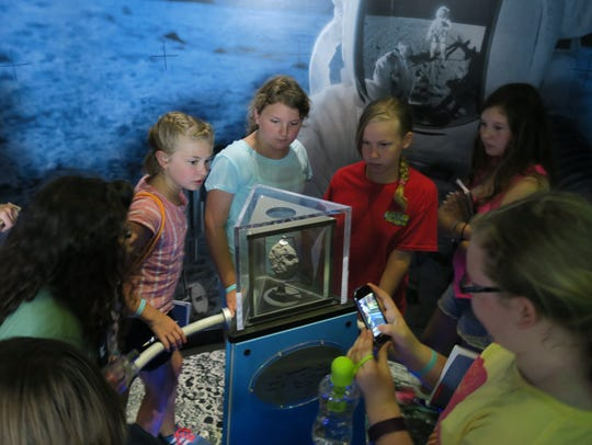 Manitowoc County girl scouts learn about Moon rock