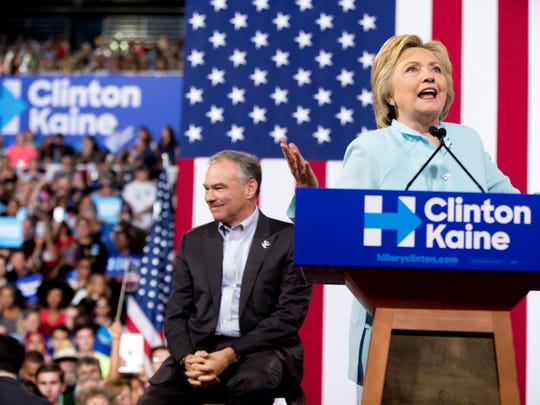 Hillary Clinton speaks as Sen. Tim Kaine, D-Va., left, looks on during a rally July 23, 2016, in Miami that marked the debut of the Democratic presidential ticket.