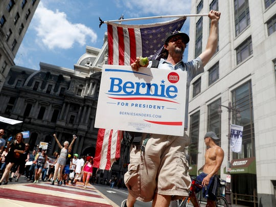 Supporters of Sen. Bernie Sanders, I-Vt., march during