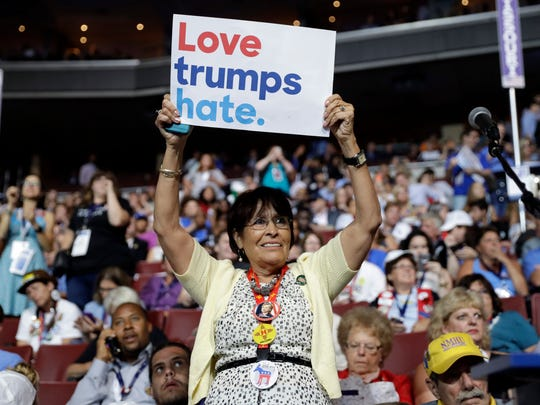 New Mexico delegate holds up a sign during the first day of the Democratic National Convention in Philadelphia , Monday, July 25, 2016.