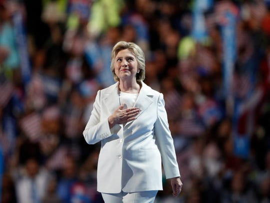 Democratic presidential nominee Hillary Clinton takes the stage to give her acceptance speech during the final day of the Democratic National Convention in Philadelphia on Thursday.