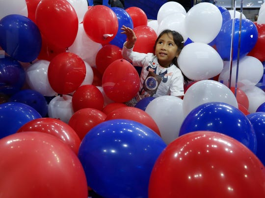 Kate Mangola, 5, plays in balloons on the floor after the Democratic National Convention in Philadelphia, Thursday, July 28, 2016.