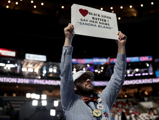 An attendee on the third day of the Democratic National