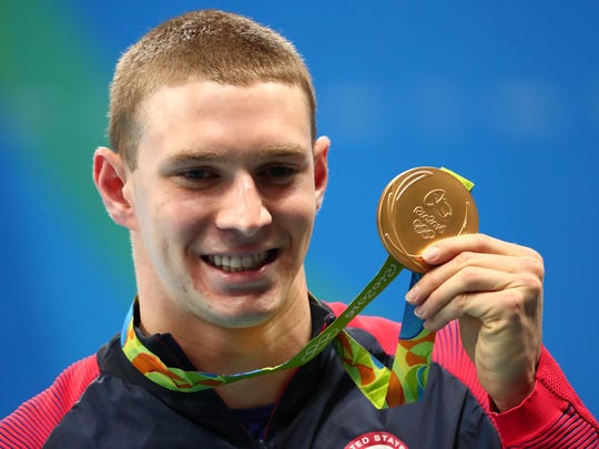 Cal swimmer Ryan Murphy celebrates after winning the gold medal during the men's 200m individual medley final in the Rio 2016 Summer Olympic Games at Olympic Aquatics Stadium.