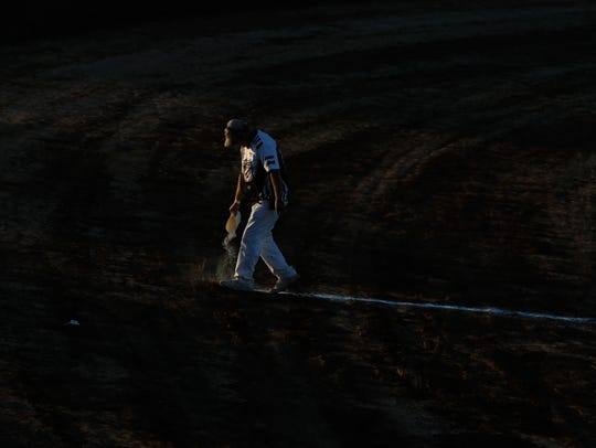 A staff of Manitowoc Speedway prepares the dirt track