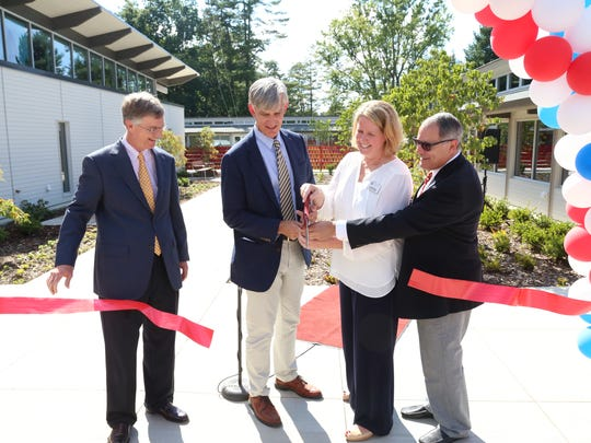 "From left, Keith Love with the ""It All Beings Here"" Campaign Committee, Kirk Duncan, Carolina Day head of school, Kim Broshar, Lower School principal, and Tom Oreck, chairman of the fundraising campaign, celebrate the grand opening of the renovated Lower School."