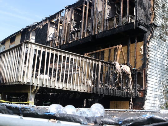 The back of a townhome in Middletown Village was heavily damaged in a Sunday fire that the Delaware Fire Marshal's Office determined was started by discarded smoking material on the deck.