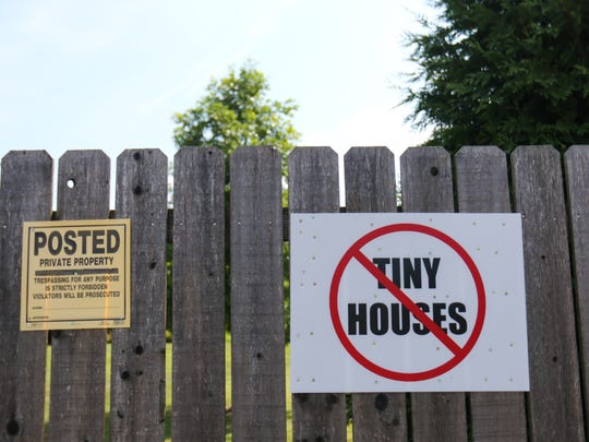 A neighbor posts a sign against the proposed tiny homes for homeless project at Victory Church near Dover. The sign is one of a handful posted on about five homes near the church.